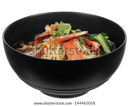 Chinese roast pork noodle bowl isolated on white background