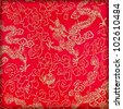 Chinese's style red cloth, dragon and treetop pattern - stock photo