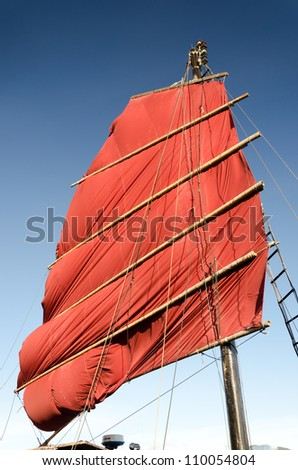 Chinese Sail in blue sky - stock photo