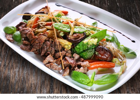 Chinese salad with wheat germs and meat.