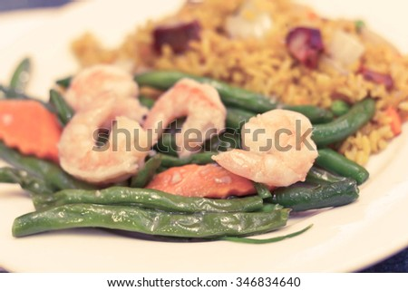 Chinese savory garlic shrimp with string beans and pork fried rice - stock photo