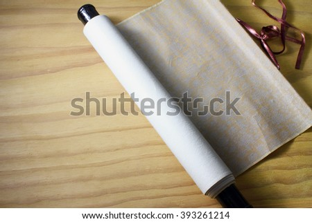 Chinese Scroll on Wooden Background - stock photo
