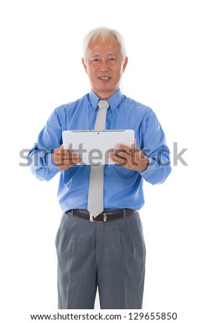 chinese senior business male with tablet - stock photo