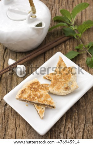 Chinese Sesame Pancakes with Oriental Teapot in Background