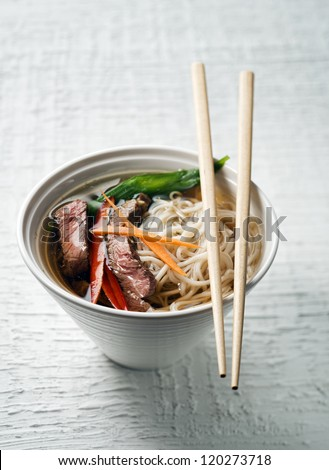 Chinese soup with beef, vegetables and noodles - stock photo