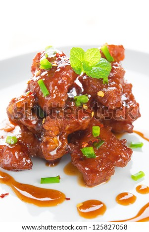 Chinese spare ribs cuisine dish, close up delicious Asian food ready to serve in plate. - stock photo