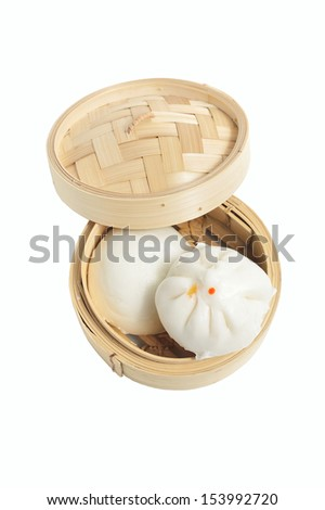 Chinese steamed buns in bamboo basket isolated on white background - stock photo