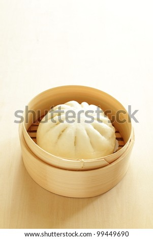 Chinese steamed dumpling, meat bun on bamboo steamer - stock photo