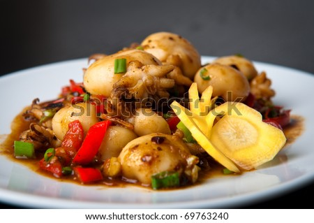 Chinese stir-fried baby squid with black bean sauce - stock photo