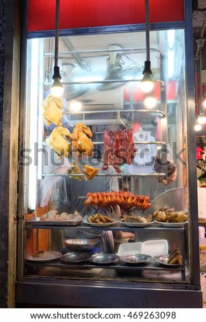 chinese street food including bbq pork and steamed chicken in a Hong Kong food stall