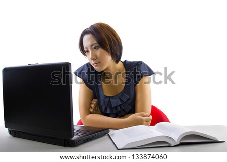 Chinese student studying.  Isolated on a white background. - stock photo