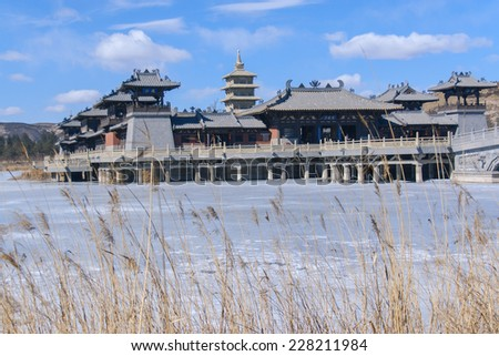 Chinese style antique imitation buildings in the center of the lake