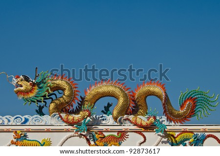 Chinese style dragon Statue on the temple's roof, Thailand.
