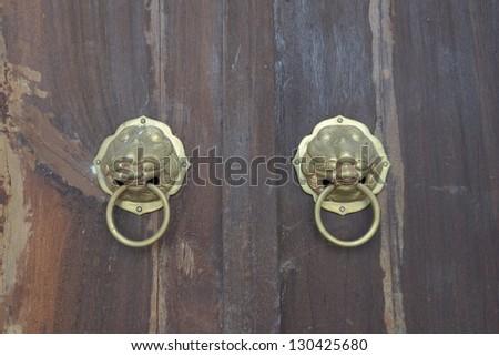 chinese-style old bronze door - stock photo