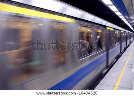 Chinese subway train pulling into the station - stock photo