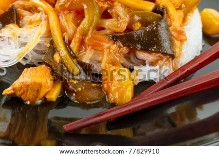 Chinese sweet and sour chicken with rice noodles