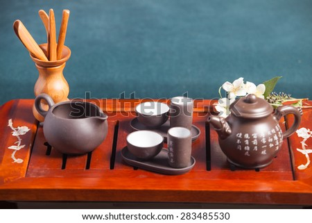 Chinese tea ceremony - close up traditional crockery - stock photo