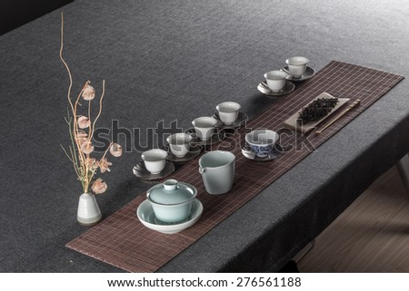 Chinese tea set and gray and towels - stock photo