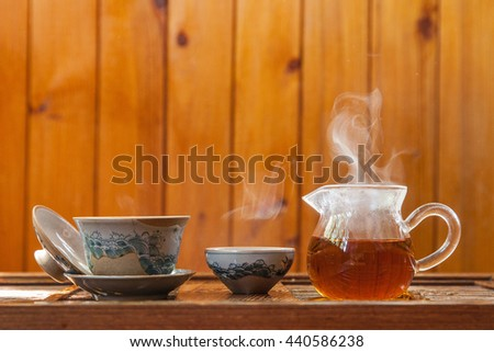 chinese tea-set for tea ceremony with black tea and vapor - stock photo