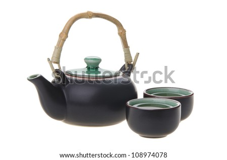 Chinese tea set with cups and tea pot on background.