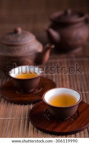 Chinese teapot and teacups set - stock photo