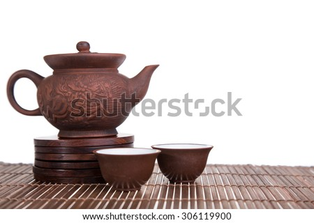 Chinese teapot and teacups set isolated on white - stock photo