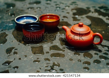 Chinese teapot and three cups of tea - stock photo