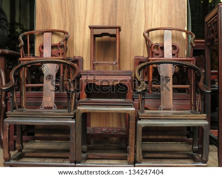 Chinese traditional Antique Furniture  with sculpture in the store. - stock photo