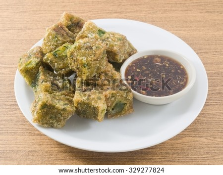 Chinese Traditional Food, A Plate of Fried Chinese Pancake or Fried Steamed Dumpling Made of Garlic Chives, Rice Flour and Tapioca Flour Served with Spicy Soy Sauce. - stock photo