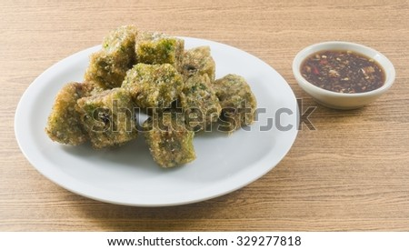 Chinese Traditional Food, Fried Chinese Pancake or Fried Steamed Dumpling Made of Garlic Chives, Rice Flour and Tapioca Flour Served with Spicy Soy Sauce. - stock photo