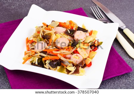 Chinese Vegetable Stew with Sausage. Paprika, Peas, Carrots. Diet Food. Studio Photo