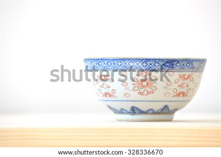 Chinese vintage style blue and white bowl on the cupboard at home (Side view).  - stock photo