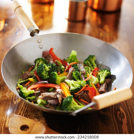 chinese wok with beef and vegetable stir fry - stock photo
