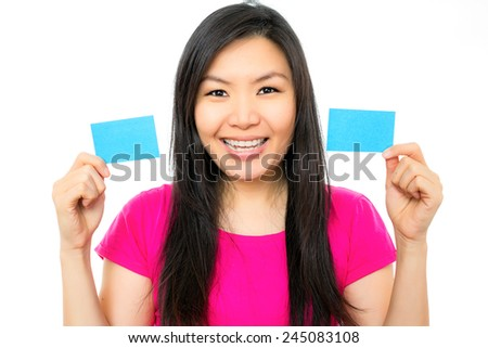 chinese woman holding blank cards or sign that can be replace by advertise - stock photo