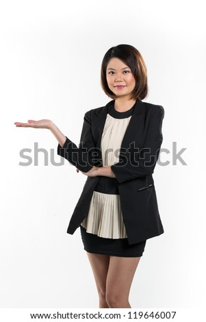 Chinese woman holding out empty hand with space for your product or message. Isolated on white background.