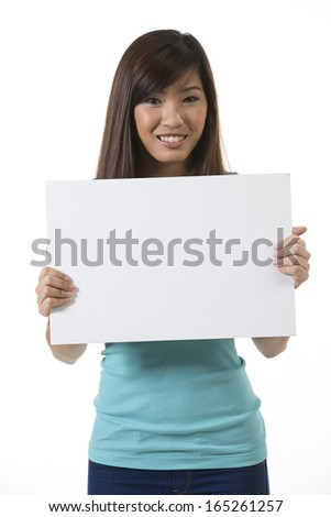 Chinese woman holding up a banner against a white background. Cardboard placard is blank ready for your message.