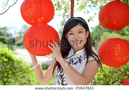Chinese woman in traditional cheongsam with smiling face - stock photo