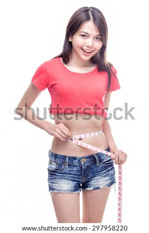 Chinese woman measuring waist with tape