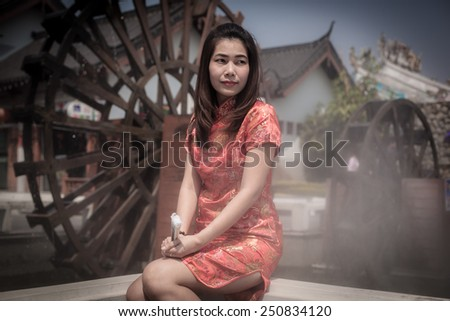 Chinese woman red dress traditional cheongsam, Chinese classical costumes - stock photo