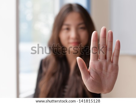 Chinese woman showing stop hand - stock photo