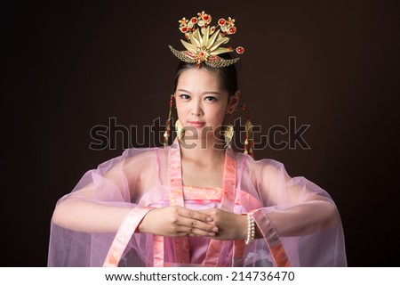 Chinese woman wearing traditional costumes - stock photo