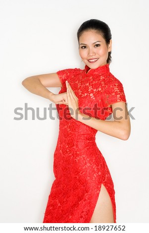 Chinese woman wearing traditonal red cheong sam