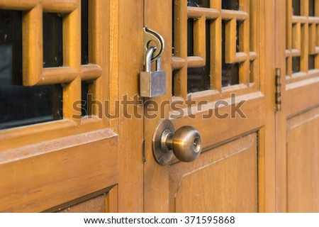 Chinese wooden door Lock and bolt lock with a brown wooden door closed doors. - stock photo