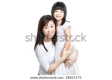 Chinese young mother and daughter both with long hair hugging one another for a family portrait - stock photo