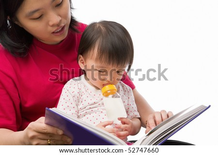 Chinese young woman story telling her cute daughter