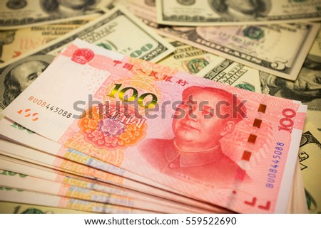 Chinese Yuan Note on U.S. dollar background  (Exchange rate concept)