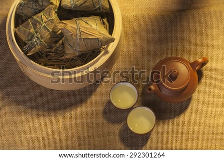 Chinese ZongZi and Green tea - stock photo