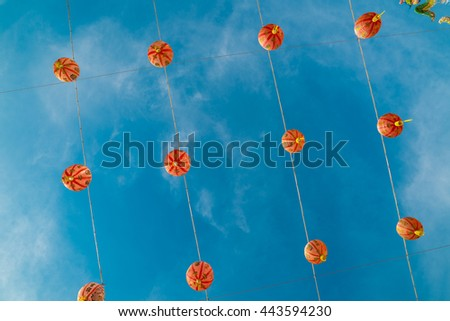 Chineses lanterns. - Vintage tone image of Chinese lanterns under blue sky background.