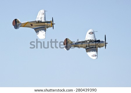 CHINO/CALIFORNIA - MAY 3, 2015: Vintage Military Aircraft displaying their flying agility at the Planes of Fame Airshow in Chino, California USA
