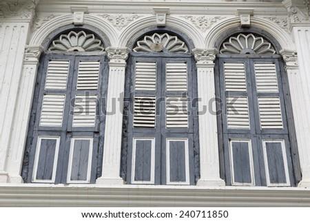 Chino-Portuguese windows in Phuket old town, Thailand - stock photo
